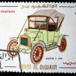 Royalty-Free Stock Photo: UMM AL QIWAIN - CIRCA 1968: A stamp printed in one of the emirates in the United Arab Emirates shows vintage car Austin-7 - 1911 year, full series - 48 of stamps, circa 1968