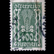 Stock Photo: AUSTRI- CIRC1924: Austripostage stamp showing spike in center of nominal value of 400 kronen, circ1924