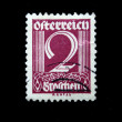 Stock Photo: AUSTRI- CIRC1928: Austripostage stamp showing spike in center of nominal value of 2 kronen, circ1928