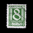 Stock Photo: AUSTRI- CIRC1928: Austripostage stamp showing spike in center of nominal value of 8 kronen, circ1928