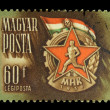 Stock Photo: HUNGARY - CIRC1950: stamp printed in Hungary shows badge sport association with image of runner, circ1950