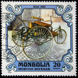 Royalty-Free Stock Photo: MONGOLIA - CIRCA 1980: A stamp printed in the Mongolia shows vintage automobile Benz 1885 year, one stamp from series, circa 1980