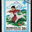MONGOLIA - CIRCA 1980: A stamp printed in Mongolia shows boy play with lambs, circa 1980 — Stock Photo
