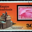 CENTRAL AFRICAN EMPIRE - CIRCA 1977: A stamp printed in Central African Empire (in present time Republic) shows old postage stamp of the airship on the background of Brandebourg gate, Berlin, Germany, — Stock Photo