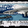 VIETNAM - CIRCA 1985: A stamp printed in Vietnam shows bridge over the river on the background of the plant, stamp is from the series, circa 1985 — Stock Photo