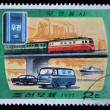 DPR KOREA - CIRCA 1977: A stamp printed by DPR KOREA (North Korea) shows cars, ship and train, series devoted to Post service, circa 1977 — Stock Photo