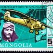 MONGOLIA - CIRCA 1978: A stamp printed in Mongolia shows pilot Ch.Lindbergh fly NewYork - Paris 1927, circa 1978 - Stock Photo