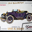 Royalty-Free Stock Photo: UMM AL QIWAIN - CIRCA 1968: A stamp printed in one of the emirates in the United Arab Emirates shows vintage car Chevrolet - 1914 year, full series - 48 of stamps, circa 1968
