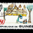 GUINEA - CIRCA 1966: A stamp printed in Guinea shows Children Drawing - African village, circa 1966 — Stock Photo #12161359
