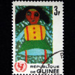 GUINEA - CIRCA 1966: A stamp printed in Guinea shows Children Drawing - African girl, circa 1966 — Stock Photo #12161360
