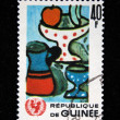 GUINEA - CIRCA 1966: A stamp printed in Guinea shows Children Drawing - pottery, circa 1966 — Stock Photo #12161363