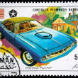 Постер, плакат: AJMAN CIRCA 1971: A stamp printed in one of the emirates in the United Arab Emirates shows muscle car Chrysler Plymouth Barracuda series circa 1971