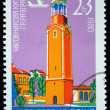 Stock Photo: BULGARI- CIRC1980: stamp printed in Bulgarishows clock tower in Razgrad, circ1980