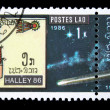 Stock Photo: LAOS - CIRC1986: stamp printed in Laos devoted to comet Halley, circ1986