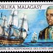 REPUBLICA MALAGASY - CIRCA 1976: A stamp printed in Madagascar shows Comte d Estaing and ship Languedoc, circa 1976 — Stock Photo