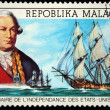 Stock Photo: REPUBLICA MALAGASY - CIRCA 1976: A stamp printed in Madagascar shows Comte de Grasse and ship Randolph, circa 1976
