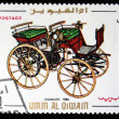 Постер, плакат: UMM AL QIWAIN CIRCA 1968: A stamp printed in one of the emirates in the United Arab Emirates shows vintage car Daimler 1886 year full series 48 of stamps circa 1968