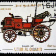 Постер, плакат: UMM AL QIWAIN CIRCA 1968: A stamp printed in one of the emirates in the United Arab Emirates shows vintage car Daimler 1897 year full series 48 of stamps circa 1968