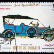 Постер, плакат: UMM QIWAIN CIRCA 1968: A stamp printed in one of the emirates in the United Arab Emirates shows vintage car Daimler 1910 year full series 48 of stamps circa 1968