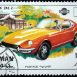 Постер, плакат: AJMAN CIRCA 1970: A stamp printed in one of the emirates in the United Arab Emirates shows muscle car Datsun 240 Z series circa 1970