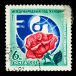 USSR - CIRCA 1975: A stamp printed in the USSR devoted to International Womens Year shows a red rose on the background of a dove and the globe, circa 1975 — Stock Photo