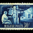 HUNGARY - CIRCA 1950s: A stamp printed in Hungary shows doctor examines the patient to X-ray machine, circa 1950s - Stock Photo