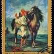"USSR - CIRCA 1972: A stamp printed in the USSR shows a painting by the artist Ferdinand Victor Eugene Delacroix ""Man from Morocco saddling a horse"", one stamp from series, circa 1972 — Stock Photo"