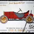 UMM AL QIWAIN - CIRCA 1968: A stamp printed in one of the emirates in the United Arab Emirates shows vintage car Fiat Grand Prix Racing Car F-2 - 1907 year, full series - 48 of stamps, circa 1968 — Stock Photo