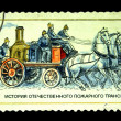 USSR - CIRCA 1984: A stamp printed in USSR shows Fire Horse crew with steam pump, stamp from series, circa 1984 — Stock Photo