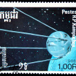 KAMPUCHEA - CIRCA 1988: A stamp printed in Kampuchea (Kingdom of Cambodia) shows first soviet Sputnik, circa 1988 - 图库照片