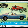 MANAMA (AJMAN) - CIRCA 1970s: A stamp printed in emirate Bahrain of the United Arab Emirates shows Ford cars, series, circa 1970s — Stock Photo #12165143