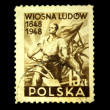 POLAND - CIRCA 1948: A stamp printed in Poland shows foreground a farmer breaks the chain in the background a group of soldiers with arms and a banner in the hands, circa 1948 — Stock Photo