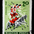HUNGARY - CIRCA 1965: A stamp printed in Hungary shows four acrobats - two men and two women are standing on the backs of three horses, circa — Stock Photo