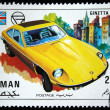 Постер, плакат: AJMAN CIRCA 1971: A stamp printed in one of the emirates in the United Arab Emirates shows muscle car Ginetta G 21 series circa 1971