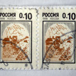 RUSSIA - CIRCA 1998: A stamp printed in Russia shows harvesting, circa 1998 - Stock Photo