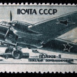 USSR - CIRCA 1946: A stamp printed in the USSR devoted Soviet air forces in World War II shows heavy bomber Petlyakov-8, series, circa 1946 - Stock Photo