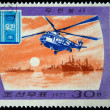 DPR KOREA - CIRCA 1977: A stamp printed by DPR KOREA (North Korea) shows helicopter on the background of ships, series devoted Post service, circa 1977 - Stock Photo