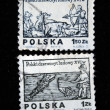 Stock Photo: POLAND - CIRC1974: Stamps printed in Poland show hunter and fisher, circ1974