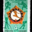 Постер, плакат: USSR CIRCA 1973: A stamp printed in the USSR shows Icon Honors motion Ready for work and defense against the figures of athletes circa 1973