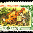 USSR - CIRCA 1961: A stamp printed in the USSR shows illustration of the Russian fairy tale - fox, rabbit and a rooster, circa 1961 - Stock Photo