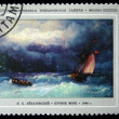Постер, плакат: USSR CIRCA 1974: a stamp printed by USSR shows a picture Stormy Sea of artist Aivazovsky world renowned Russian marine painter battle scenes collector and philanthropist circa 1