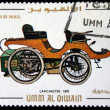 Постер, плакат: UMM AL QIWAIN CIRCA 1968: A stamp printed in one of the emirates in the United Arab Emirates shows vintage car Lanchester 1895 year full series 48 of stamps circa 1968
