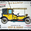UMM AL QIWAIN - CIRCA 1968: A stamp printed in one of the emirates in the United Arab Emirates shows vintage car Lanchester-28 - 1910 year, full series - 48 of stamps, circa 1968 — Fotografia Stock  #12168061