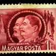 HUNGARY - CIRCA 1950: a stamp printed in Hungary shows Stalin and Lenin. Circa 1950 - Stock Photo