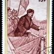 BURUNDI - CIRCA 1970: A stamp printed in Republique du Burundi shows Lenin on the podium before the Red Army, circa 1970 - Foto de Stock  