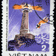 VIETNAM - CIRCA 1985: A stamp printed in Vietnam shows lighthouse and falling airplane at the background, circa 1985 — Stock Photo