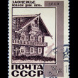 USSR - CIRCA 1968: A stamp printed in the USSR shows Living house from logs in Zaonezjie, Karelia, Russia, circa 1968 - 图库照片
