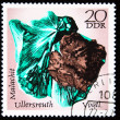 DDR - CIRCA 1985: A stamp printed in DDR (East Germany) shows semiprecious stone Malachit, circa 1985 - Stok fotoğraf