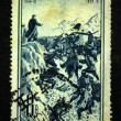 CHINA - CIRCA 1955: A stamp printed in China shows Mao Zedong stood on the hill watching for during the Long March, circa 1955 - 图库照片