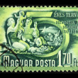 HUNGARY - CIRCA 1950s: A Stamp printed in Hungary shows married couple with two children resting on the beach, series 5 year plan, circa 1950s — Stock Photo